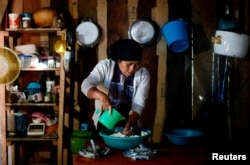 Karima Gomez, 66, a Muslim from the Tzotzil Maya ethnic group, cooks tortillas inside her house in San Cristobal de las Casas, in Chiapas state, Mexico, Aug. 12, 2017.