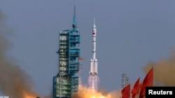 2012年6月12日,中国神舟九号在甘肃酒泉卫星发射基地发射。(资料照片)