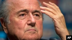 FIFA President Sepp Blatter talks about the organization and infrastructure of the upcoming World Cup during a press conference in Sao Paulo, Brazil, June 5, 2014.