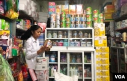 Various brands of baby formulas sold in Svay Rieng province in eastern Cambodia. At 9 P.M. a father came to buy a 0-6 month baby formula at the local store for the newborn baby, on October 11, 2019. (Khan Sokummono/VOA Khmer)