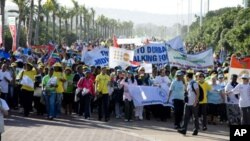 In Durban, South Africa, midwives and their supporters hold a march, June20, 2011. The march was held in conjunction with the release of a new report calling for 112,000 additional midwives.