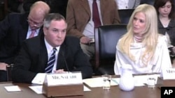 Tareq (L) and Michaele Salahi appear before the House Committee on Homeland Security, 20 Jan 2010