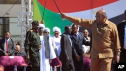 "Sudan's President Omar al-Bashir greets his supporters at a rally in Khartoum, Sudan, Wednesday, Jan. 9, 2019. Al-Bashir told the gathering of several thousands of supporters in the capital that he is ready to step down only ""through election."""