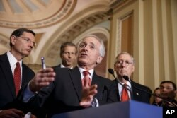 FILE - Senate Foreign Relations Committee Chairman Bob Corker, R-Tenn., outlines his bipartisan bill requiring congressional review of any comprehensive nuclear agreement that President Barack Obama reaches with Iran, at the Capitol in Washington, March 3, 2015.