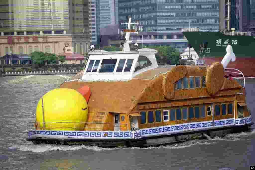 A ferry boat made to look like a roast duck plies on the Huangpu River in Shanghai, China.