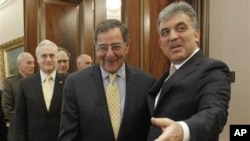 U.S. Sec. of Defense Leon Panetta, center, is greeted by Turkish President Abdullah Gul, right, before the start of their meeting in Ankara, Turkey, Dec., 16, 2011.