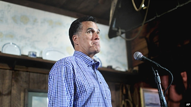 Republican presidential candidate, former Massachusetts Governor Mitt Romney holds news conference after talking with local business owners at a town hall meeting in Hampton, New Hampshire, July 5, 2011