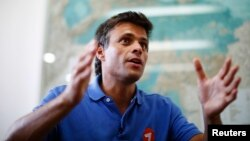 FILE - Venezuelan opposition leader Leopoldo Lopez speaks during an interview in Caracas, Feb. 11, 2014.