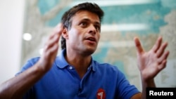 Venezuelan opposition leader Leopoldo Lopez speaks during an interview in Caracas, Feb. 11, 2014.