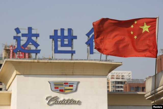 China's national flag flutters at Cadillac's dealership in Beijing, China, March 14, 2016.