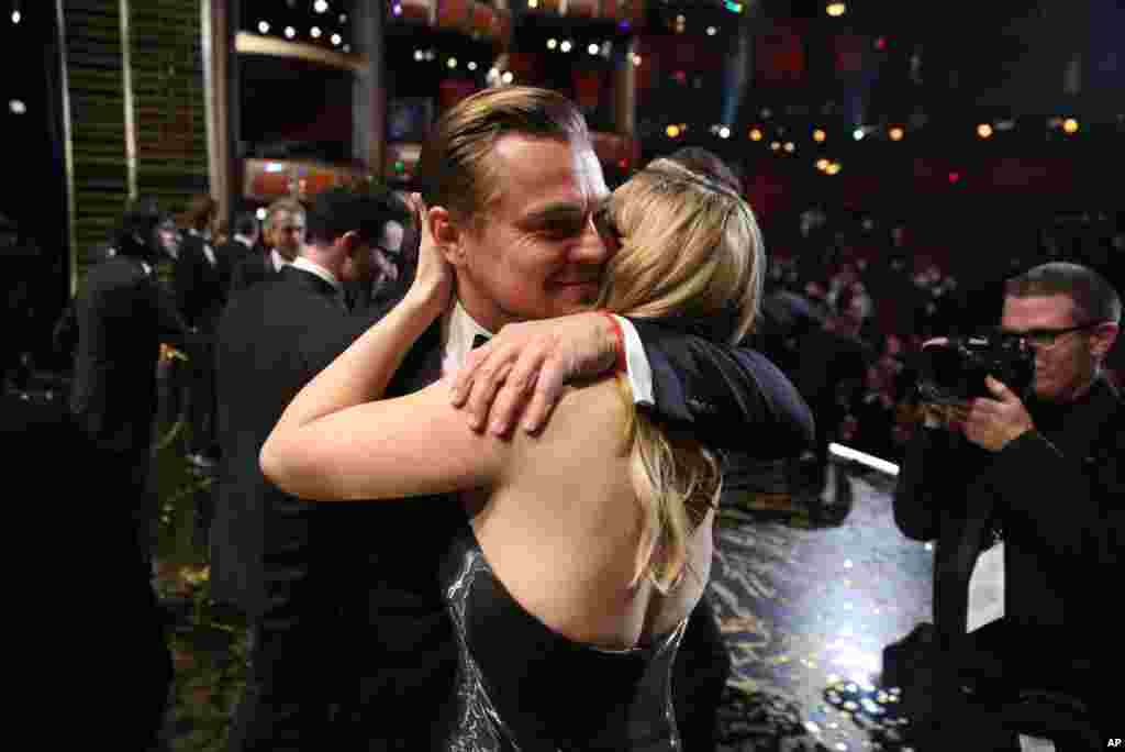 "Leonardo DiCaprio, winner of the award for best actor in a leading role for ""The Revenant"", left, embraces Kate Winslet backstage at the Oscars on Feb. 28, 2016, at the Dolby Theatre in Los Angeles."