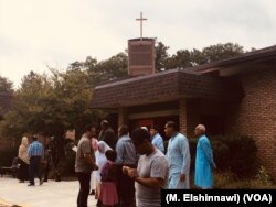 American Muslims from different countries perform Eid al-Adha prayer services in the Saint Andrews Church, Burke, Virginia, August 21, 2018.