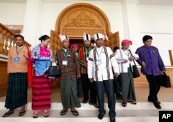 Clad in ethnic Chin and Myanmar traditional attire, newly elected members of parliament from Myanmar opposition leader Aung San Suu Kyi's National League for Democracy party gather at the Lower House of parliament in Naypyitaw, Myanmar, Jan. 27, 2016.