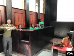 Some of the people arrested after last week's opposition protest follow proceedings at Harare Magistrates' Court where the Zimbabwe Lawyers for Human Rights applied for their bail. (C. Mavhunga/VOA)