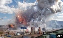 A massive explosion guts Mexico's biggest fireworks market in Tultepec, Dec. 20, 2016.