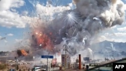 FILE - A massive explosion guts Mexico's biggest fireworks market in Tultepec, Dec. 20, 2016.