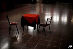 A table and chairs sit amid the empty dance floor of La Viruta Tango club, closed during the COVID-19 pandemic lockdown in Buenos Aires, Argentina, Friday, June 4, 2021.