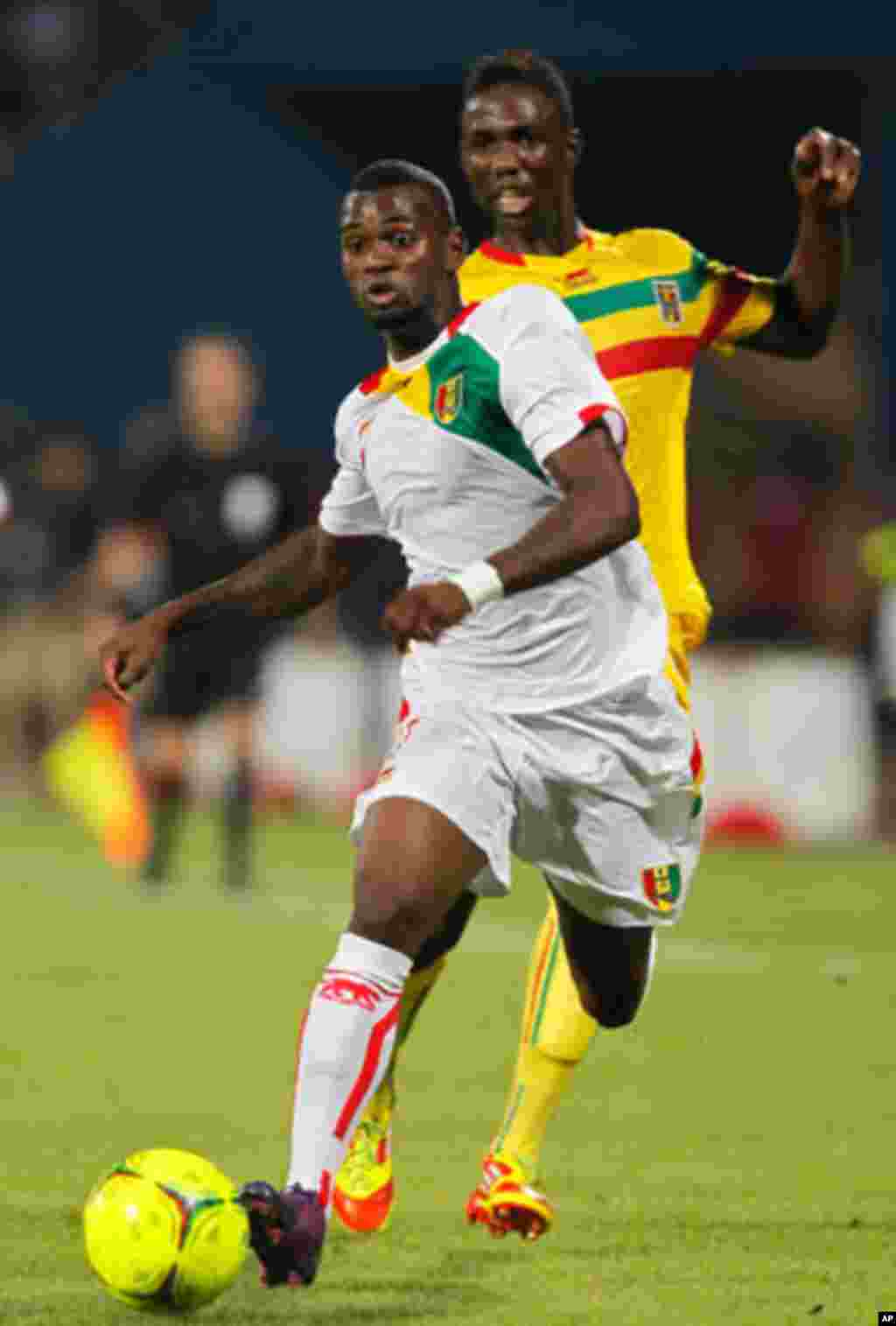 Guinea's Abdoul Razzagui Camara challenges Mali's Modibo Maiga for the ball during their African Nations Cup Group D soccer match at Franceville Stadium