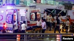 Ambulances arrive at Istanbul Ataturk Airport, Turkey, following explosions, June 28, 2016.