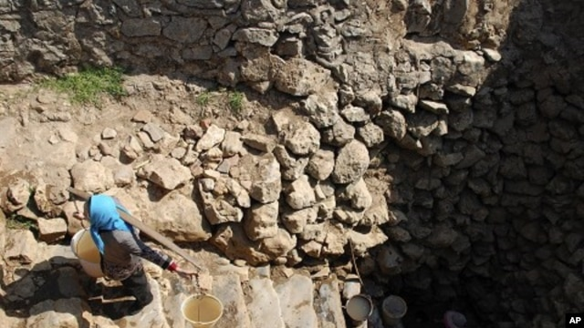 A farmer carrying water collected from a nearly dried-up well climbs a stairs at a village in Xiping county, Yunnan province, February 22, 2012.
