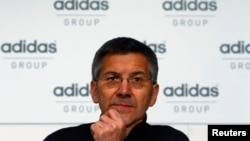 FILE - Herbert Hainer, chief executive officer of Adidas, the world's second largest sports apparel firm, pauses during the company's annual news conference in Herzogenaurach, March 7, 2013.