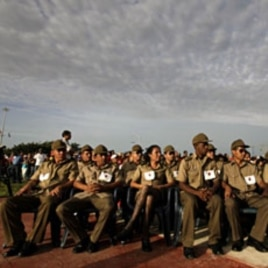 Members of the Cuban Armed Forces attend an event marking the 1953 assault on the Moncada military barracks in Ciego de Avila, Cuba July 26, 2011