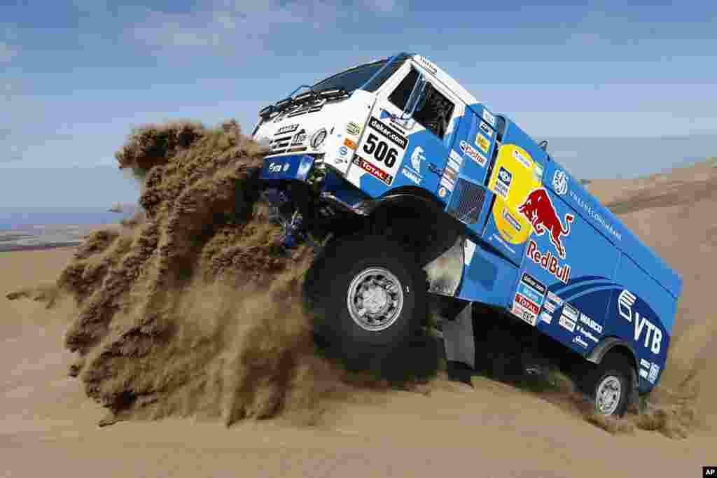 Driver Andrey Karginov and co-pilots Andrey Mokeev and Igor Devyatkin, all from Russia, ride their Kamaz truck up a dune during the tenth stage of the Dakar Rally between the cities of Iquique and Antofagasta, Chile, Jan. 15, 2014.