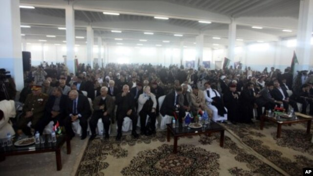 People attend a founding conference of the council of the Cyrenaica province in Benghazi, March 6, 2012.