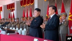 FILE - North Korean leader Kim Jong Un, center, along with Liu Yunshan, China's Communist Party's No. 5 leader, second right, claps hands during the ceremony to mark the 70th anniversary of the country's ruling party in Pyongyang, October 10, 2015.