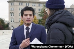 Jirayuth Latthivongsakorn, a DACA recipient, and a reporter after the Supreme Court's DACA hearing