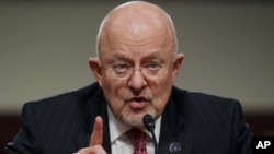 FILE - U.S. intelligence chief James Clapper, shown testifying before Congress in February 2014, says a U.S. decision to arm Ukraine could spur Russia to give more advanced weaponry to the separatists.