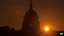 The sun rises over the Capitol in Washington, Sept. 24, 2013. (AP)