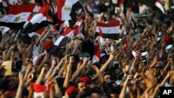 Egyptians listen to the speech of Egypt's President-elect Mohamed Morsi, in Tahrir Square in Cairo, Egypt, Friday, June 29, 2012.
