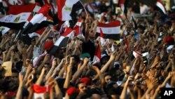 Egyptians listen to the speech of Egypt's President-elect Mohamed Morsi, in Tahrir Square in Cairo, Egypt, Friday, June 29, 2012.
