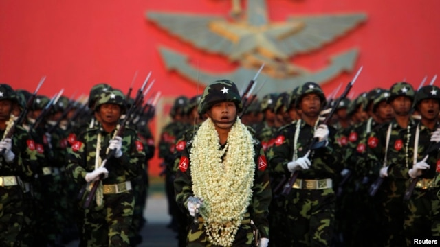Soldiers salute Burma's army chief General Min Aung Hlaing during a parade in Naypyitaw, Mar. 27, 2012.