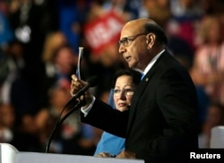 FILE - Khizr Khan, whose son Humayun was killed serving in the U.S. Army, challenges Republican presidential nominee Donald Trump to read his copy of the U.S. Constitution at the Democratic National Convention in Philadelphia, July 28, 2016.