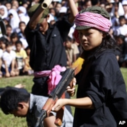 Cambodian students re-enact torture executed by the Khmer Rouge to mark the annual 'Day of Anger' at Choeung Ek, a former Khmer Rouge 'killing field' dotted with mass graves about nine miles (15 kilometers) south of Phnom Penh (File Photo)