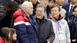 U.S. Vice President Mike Pence, center left, and South Korean President Moon Jae-in attend the women's 500 meters short-track speedskating in the Gangneung Ice Arena at the 2018 Winter Olympics in Gangneung, South Korea, Feb. 10, 2018. U.S. second lady Karen Pence is seen bottom left.