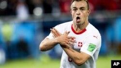 Xherdan Shaqiri celebrating after scoring the 2nd Swiss goal