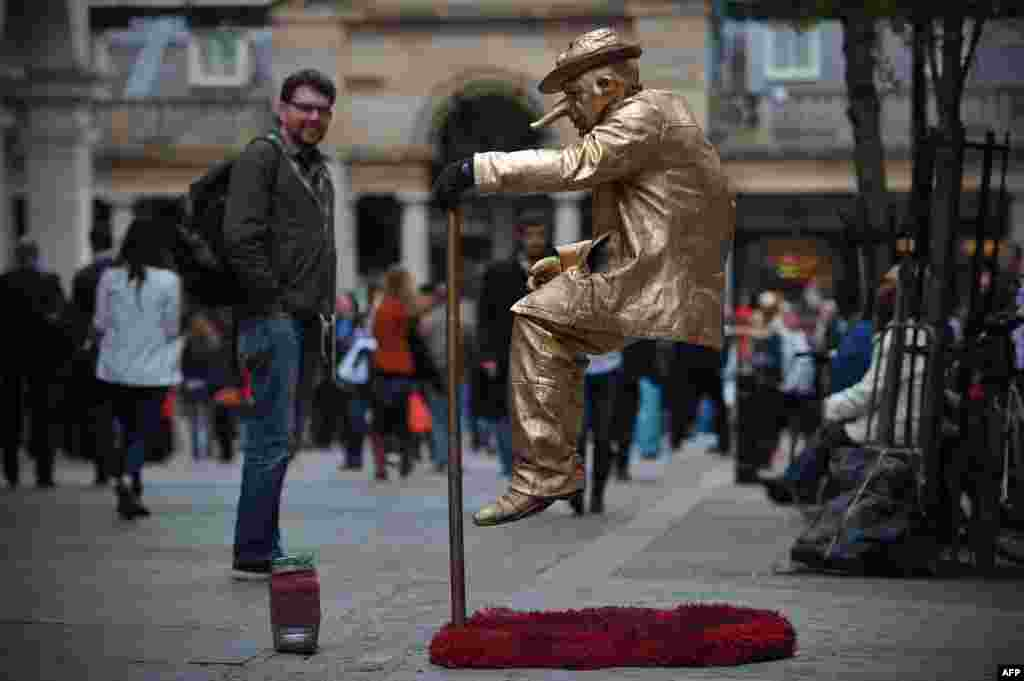 A street artist performs in Covent Garden in central London.