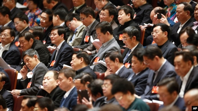 Chinese top leaders attends the third plenary session of the National People's Congress (NPC) at Great Hall of the People in Beijing, China, Monday, March 10, 2014.