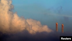 FILE - Vapor rises from Liddell Power Station near Muswellbrook, 170 km (106 miles) north of Sydney, Nov. 2, 2011.