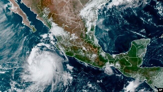 This satellite image provided by the National Oceanic and Atmospheric Administration shows a Tropical Storm Pamela in the Pacific as it approaches Mexico, Oct. 11, 2021.