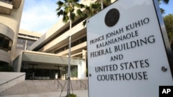 FILE - A sign for the Hawaii U.S. federal court stands outside the building in Honolulu on Wednesday morning, March 15, 2107.