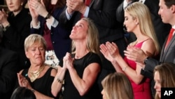 "Carryn Owens, widow of Navy SEAL William ""Ryan"" Owens, is applauded on Capitol Hill in Washington, Feb. 28, 2017, as she was acknowledged by President Donald Trump during his address before a joint session of Congress."