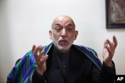 FILE - Former Afghan President Hamid Karzai speaks during an interview with the Associated Press in Kabul, Afghanistan, April 17, 2017.