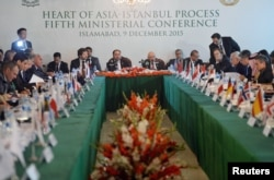 Pakistan's National Security Advisor Sartaj Aziz (C-R), Afghan Foreign Minister Salahuddin Rabbani (C-L), and other countries delegates attend the first day of the Heart of Asia conference in Islamabad, Dec. 9, 2015.