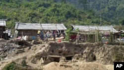 Bomb shelters built by Kachin refugees, at the Je Yang IDP camp, near Laiza, northeastern Burma, Friday, Jan. 4, 2013.