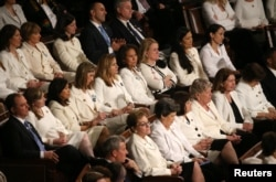 Democratic women of the U.S. House of Representatives listen to President Donald Trump's second State of the Union address to a joint session of the U.S. Congress in the House Chamber of the U.S. Capitol in Washington, Feb. 5, 2019.