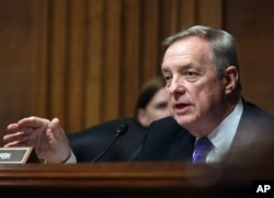 "FILE - Illinois Democratic Senator Dick Durbin pledges to be ""respectful of the office of the presidency"" during Tuesday speech by President Donald Trump."